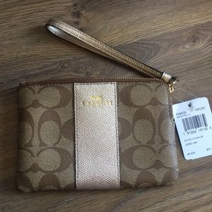 Coach Wristlet in gold and Signature NWT